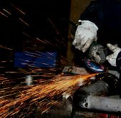 stock photo of tig  - welder at work with protection glowes  - JPG