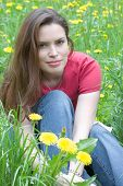 Brunette On A Dandelion Field