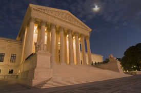 image of hughes  - A night shot of the front of the US Supreme Court in Washington DC.