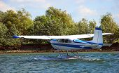 stock photo of cessna  - a cessna hydroplane landing on the shore of the richelieu river in quebec canada - JPG
