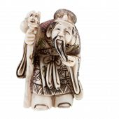 stock photo of phylacteries  - statuette of Chinese god of wealth  - JPG