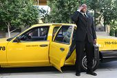 Business Man Exiting Taxi poster