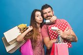Guy With Beard And Lady Do Shopping. Shopping And Fashion poster