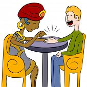 An image of a psychic palm reader with a client.