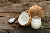 Coconut With Coconut Oil On Wooden Table Background. Good For Package Design Element poster