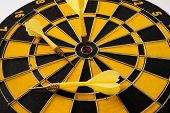 Yellow Dart Arrow Hitting In The Target Center Of Dartboard. poster