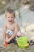 Young Boy Having Fun At Beach