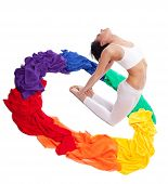 Woman doing yoga exercise - rainbow color ring