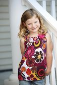 Cute Young Girl Leaning On Railing