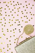 Festive Evening Golden Clutch With Star Sprinkles On Pink. Holiday And Celebration Background. Luxur poster