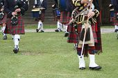 foto of bagpipes  - highland band with bagpipes and drums front view  - JPG