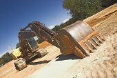 stock photo of exhumed  - An industrial excavator at a construction site - JPG