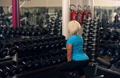 Bodybuilding. Strong Fit Female Exercising With Weight. Blond Girl Lifting Weights In Gym. Strong Wo poster