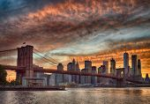 Silhouette Of Manhattan Skyline With Brooklyn Bridge At Sunset - Hdr Image. poster