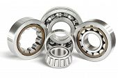 stock photo of friction  - Four roller and ball bearings on a white background - JPG