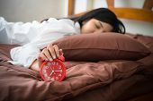 Young Woman Awakening Tired Insomnia Holding Alarm Clock. Wake Up Early In Morning. Girl Stop Snooze poster