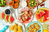 Summer Bbq Or Picnic Food Concept. Selection Of Fruits, Salad, Grilled Meat And Potatoes. Top View T poster