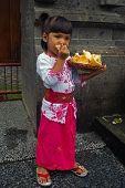 Balinese (Indonesian) Girl Eating Prawn Crackers