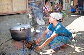 LOMBOK, INDONESIA-FEBRUARY 14: Woman makes Indonesian food on traditional way on February 14, 2012 i