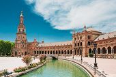 Seville, Spain. Canal Promenade Around Famous Landmark - The Plaza De Espana In Seville, Andalusia,  poster