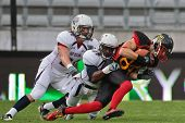 INNSBRUCK, AUSTRIA - JULY 10 WR Niklas R?mer (#84 Germany) is tackled at the Football World Championship on July 10, 2011 in Innsbruck, Austria. USA wins 48:7 against Germany.