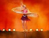 SHANGHAI, CHINA - NOVEMBER 28: A gymnast from the world famous Shanghai acrobats performs a balancin