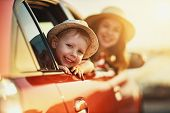 Happy  Family Mother And Child Boy Goes To Summer Travel Trip In The Car poster