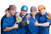 foto of team building  - A friendly young team of construction workers shows thumbs sign okay - JPG