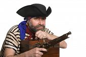 Pirate with a musket holding a treasure chest. Isolated on white.