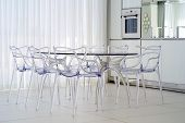 A Large Glass Table With Plastic Chairs In The Living Room Of The Hotel. Interior Of The Living Room poster