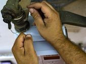 Worker Insert The Seals To The Fitting Between The Pipe And Gas Meter. Selective Focus poster
