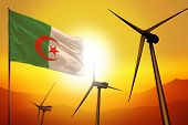 Algeria Wind Energy, Alternative Energy Environment Concept With Turbines And Flag On Sunset - Alter poster