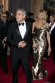 LOS ANGELES - FEB 26:  George Clooney; Stacy Keibler arrives at the 84th Academy Awards at the Holly