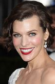 LOS ANGELES - FEB 26:  Milla Jovovich arrives at the 84th Academy Awards at the Hollywood & Highland