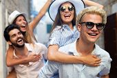 Young Happy Friends Tourists Sightseeing In City At Summer poster
