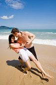 Romantic Couple Dancing At The Beach