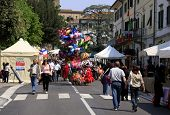 VINCI, ITALY - APRIL 18, 2009. People, tourists visit the local market in the town.