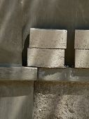 picture of cinder block  - Cinder blocks stacked on a ledge on a wall - JPG