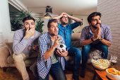 Men Watching Sport On Tv Together At Home Screaming Cheerful. Group Of Friends Sitting On The Couch  poster