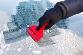stock photo of ice-scraper  - Scraping ice from the car window - JPG