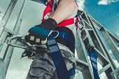Safety Harness Equipment Closeup. Caucasian Contractor In His 30s On A Steel Building Frame. Working poster