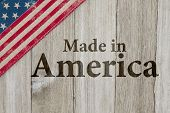 Made In America Message, Usa Patriotic Old Flag On A Weathered Wood Background With Text Made In Ame poster