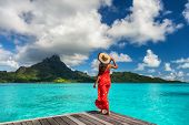 Bora Bora island luxury resort hotel woman relaxing at view of Mt Otemanu in Tahiti, French Polynesi poster