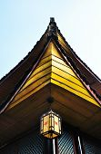 picture of emei  - Temple detail showing roof tiling and traditional wooden construction with Chinese lantern - JPG