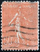 stamp printed in France shows marianne sowing