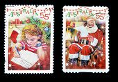 AUSTRALIA - CIRCA 2010: Two stamps printed in Australia shows Girl writing letter to Santa Claus and
