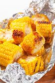 Pieces of grilled sweet corn in tin foil
