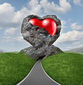 image of struggle  - Relationship difficulties with a heart of stone breaking up to expose a red shaped valentine symbol as a diamond in the rough representing challenges of marriage and dating - JPG