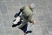 stock photo of tora  - old man with wlaking stick wearing jewish kippa jerusalem israel - JPG
