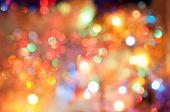 Abstract background with bokeh defocused colorful lights - image of defocused lights on the Christma